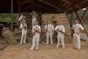 Farm Wedding Groomsmen with Rigles